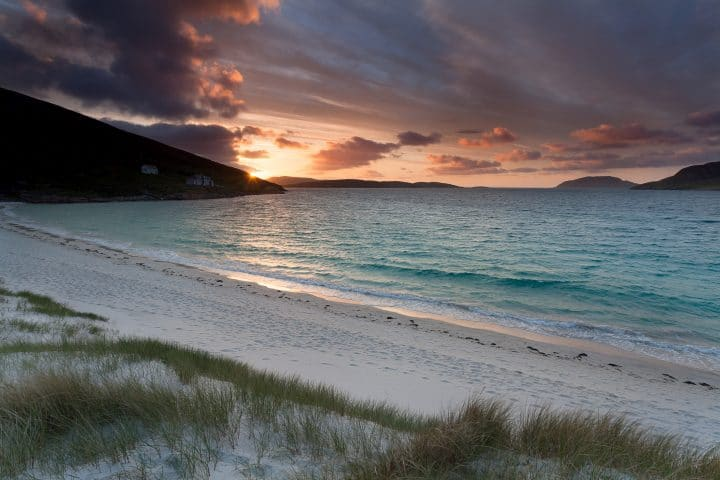 Sunrise on a scottish beach . Isle of Vatersay, Outer Hebrides of Scotland .