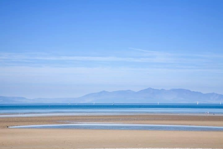 Scotland, view over Firth of Clyde toward Arran Island, blue, sea, sky, atlantic ocean, calm, yacht, walking, people, beach, sandy, dog, hills, mountains, beautiful, nature, natural, background