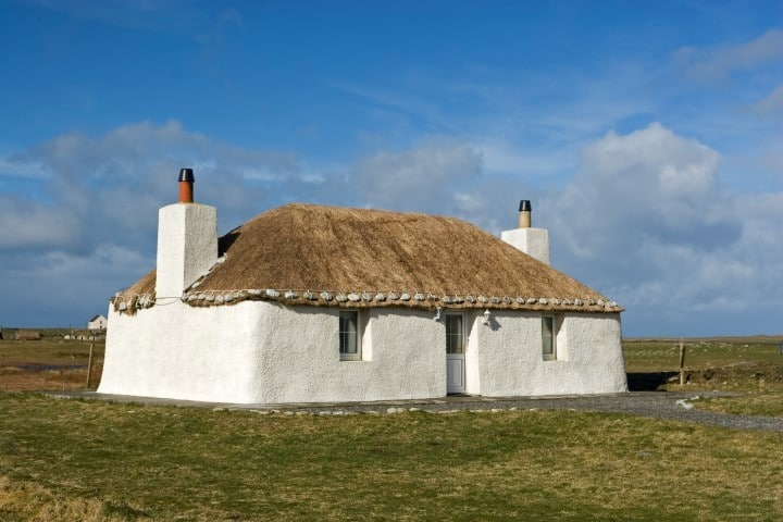 A traditional thatched whitewashed cottage in South Uist, The Outer Hebrides, Scotland.