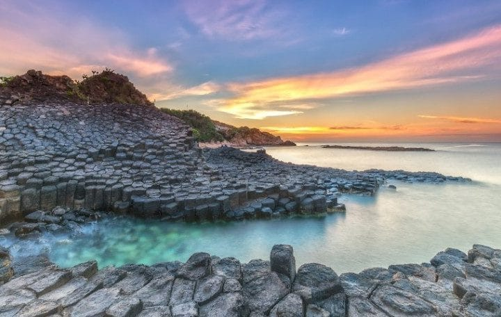 Sunrise on Giant Causeway, Phu Yen, Vietnam as the sun radiating aura prepared horizon to catch a beautiful new day