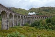 Jocobite steam train crossing the Glenfinnan railway viaduct in Scotland