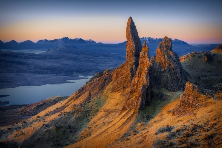 First light at sunrise over Old Man of Storr, Isle of Skye, Scotland, UK, on a cold morning