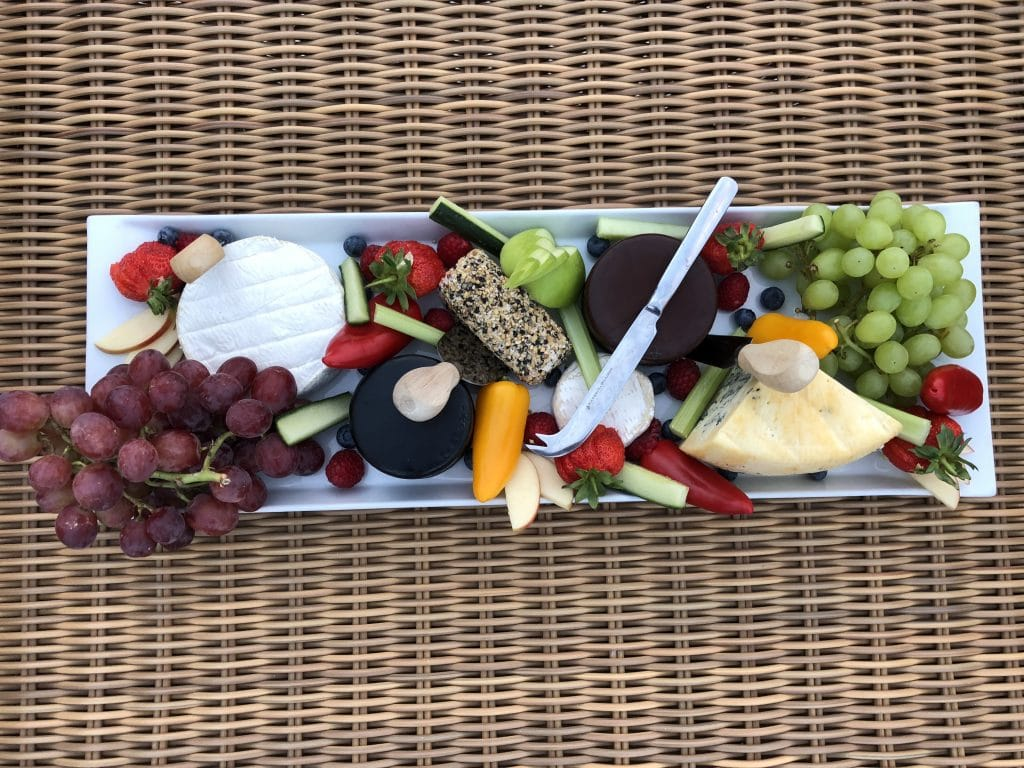 Cheeses and grapes on a platter